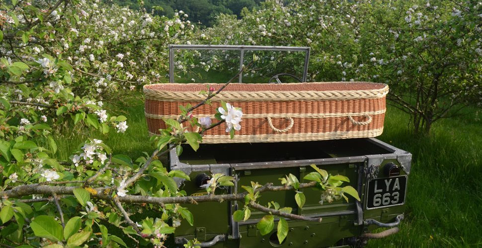 Wicker Coffin on Land Rover in Blossom
